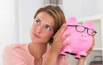 Woman Shaking Piggybank
