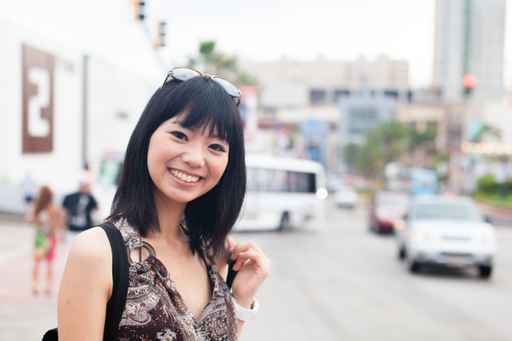 a young asian woman in the city