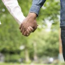Couple taking a walk hand in hand in the park