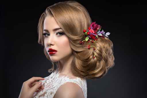 beautiful blond girl  in image of the bride with purple flowers