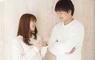 Young couple laughing happily face to face