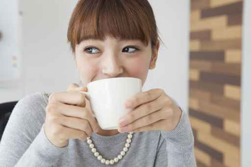 Women are drinking hot coffee in the office