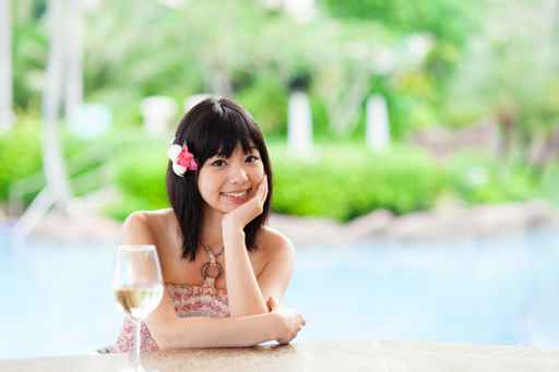 a young asian woman relaxing in the resort hotel