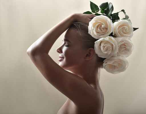 Beautiful woman with flowers in her hair. Bouquet of Beautiful F