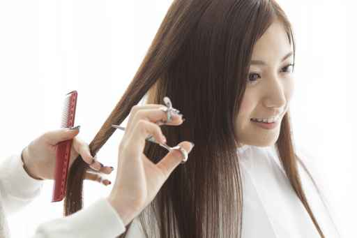Women are cut the hair happily