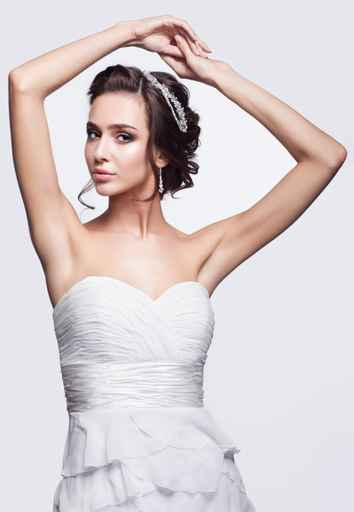 Portrait of beautiful young brunette woman bride in white Weddin