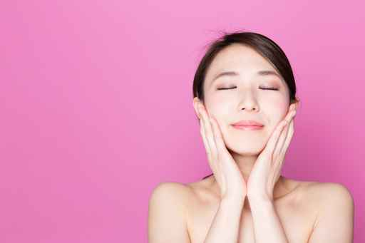 attractive asian woman on pink background