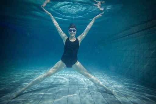 Pretty woman stretching underwater