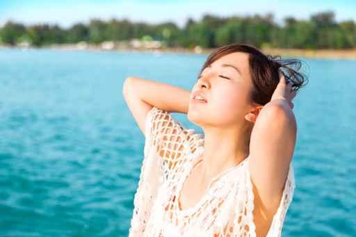 Asian young beautiful woman relaxing in the beach