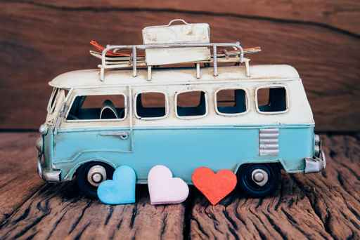 Hearts with blue van background on old wooden table.